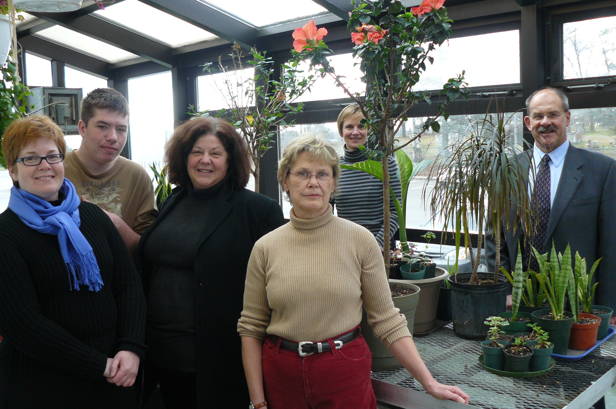 2009 Photo at Lourdes greenhouse from left to right: Anne MacKay (Grants Committee, Guelph Community Foundation); Justin Kyle Evans (student); Eileen Clinton (Principal of Alternative Learning, WCDSB); Sharon Stewart (Executive Director, The Julien Project). In background: Andrea Olson (Executive Director, Guelph Community Foundation) and John Candiotto (Principal, Our Lady of Lourdes CHS).
